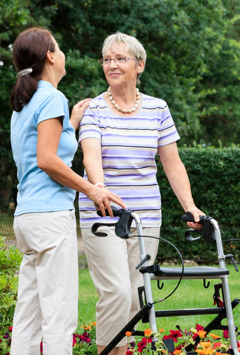 An Older Woman with a Walker and a Younger Woman