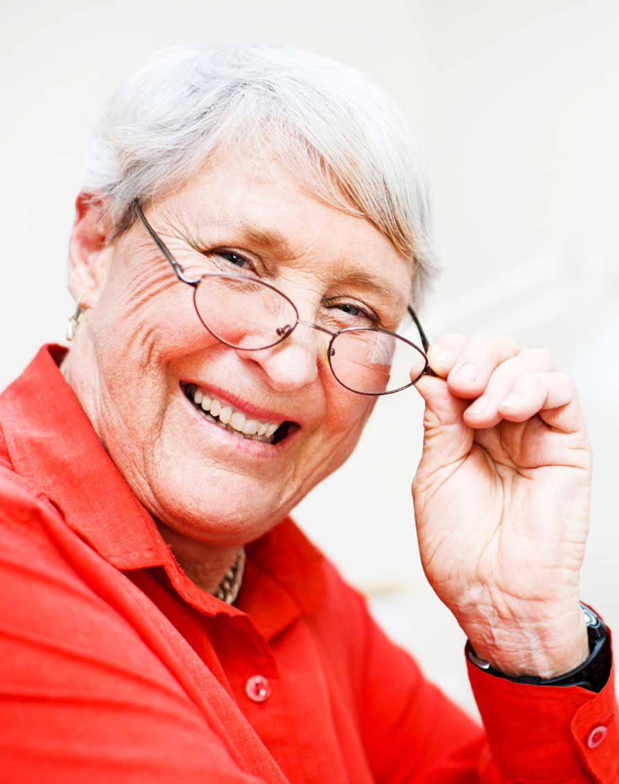 A Smiling Older Woman in Glasses