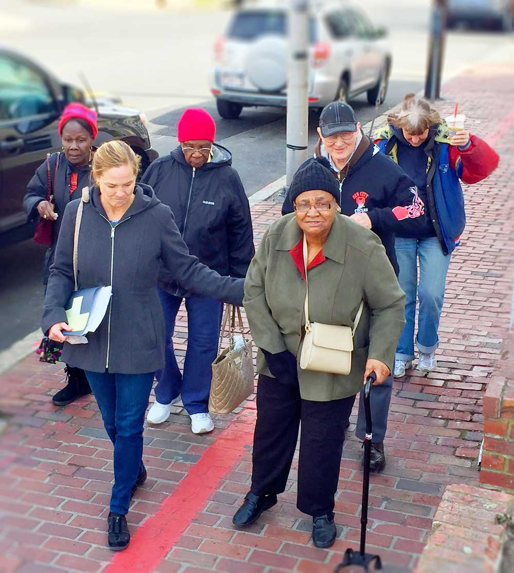 Group of Older Adults on City Street With Travel Trainer